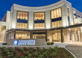 Affinity Specialty Building at Broadmoor exterior light up at night